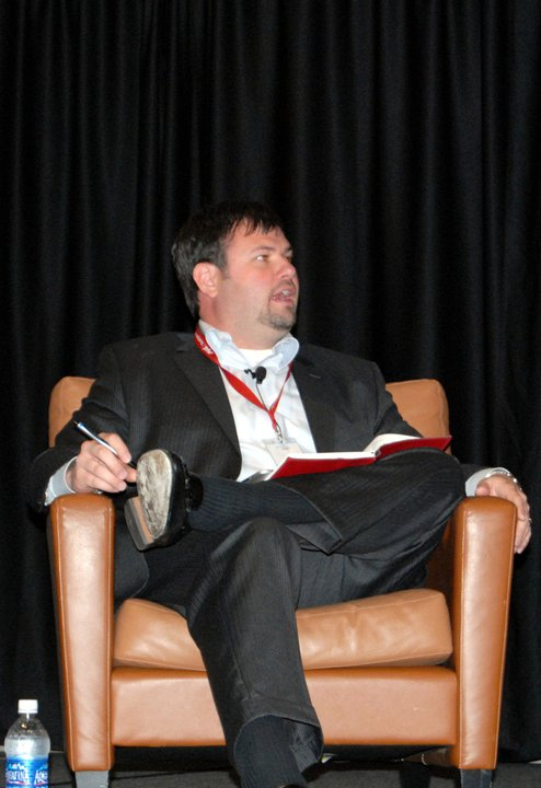 Jeremy Floyd moderating a panel at Social Slam 2012