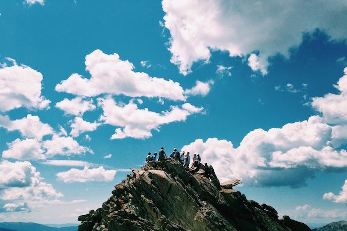 Team summiting a mountain